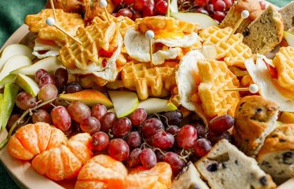waffle tree egg sandwich on a breakfast board