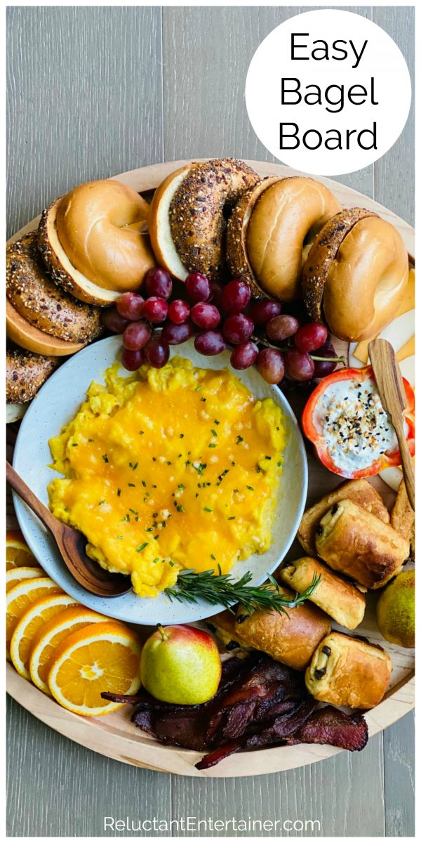 an bagel board with eggs, meat, cheese