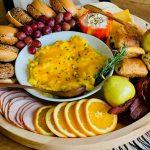 round wood board with breakfast bagel foods
