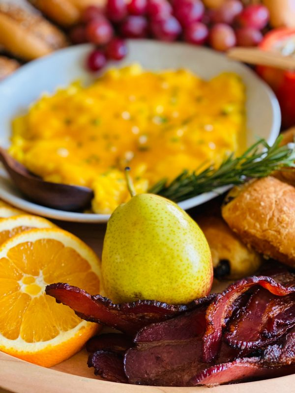 bacon, pear, oranges, and eggs