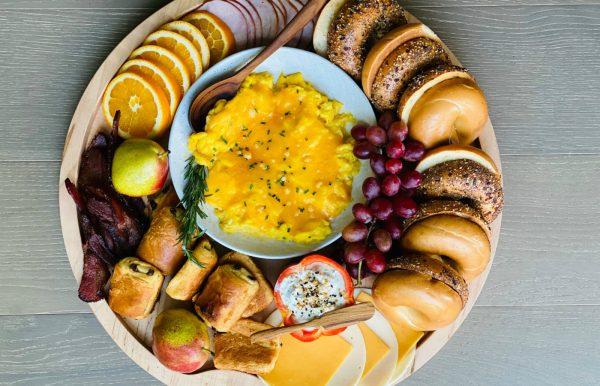 Breakfast Easy Bagel Board with scrambled eggs in the center