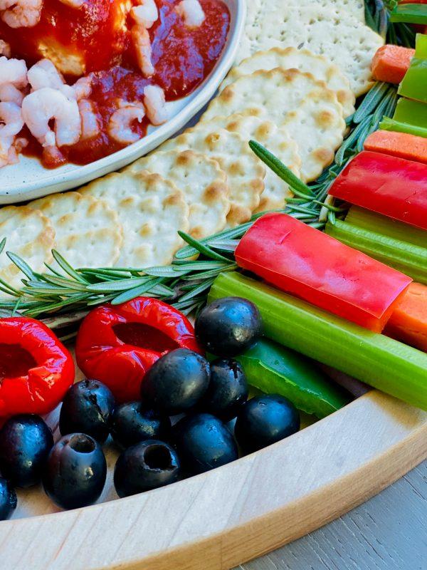 veggies and olives on a Holiday Shrimp Cocktail Crudités