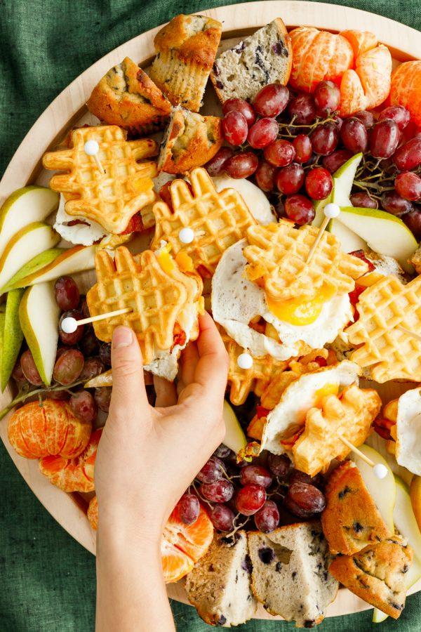 holding a waffle breakfast sandwich