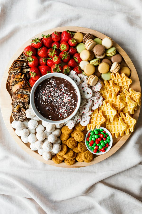 a round christmas dessert board