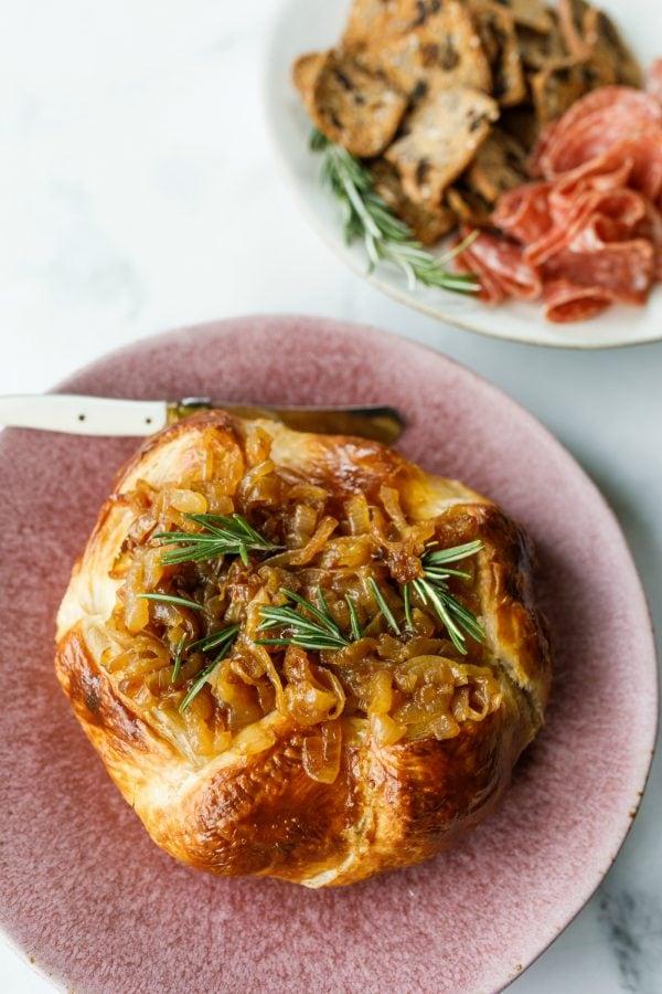 Onion Brie En Croute on a serving plate