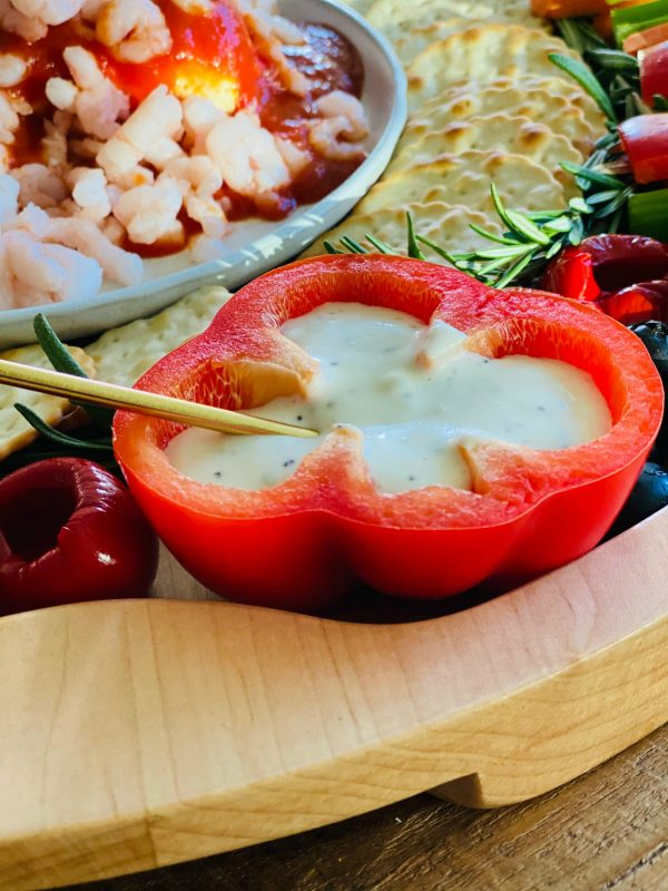 Ranch dressing in a halved red pepper