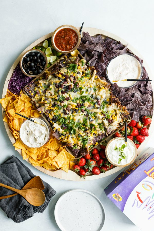 nacho board with chips and toppings