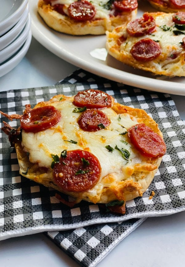 Engliish Muffin Pepperoni Pizza on a black and white checked napkin