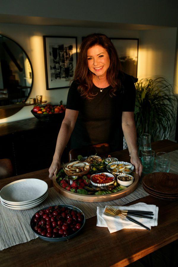 woman holding a Chicken Faro Salad Board