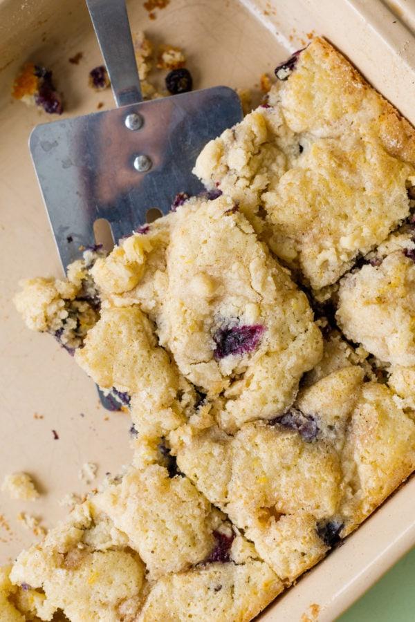 cutting squares of Best Blueberry Kuchen Recipe