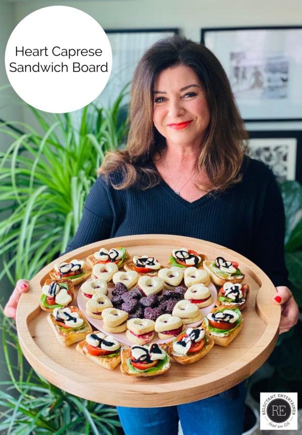 woman holding Heart Caprese Sandwich Board