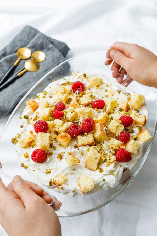 holding glass bowl of Pound Cake Lemon Trifle
