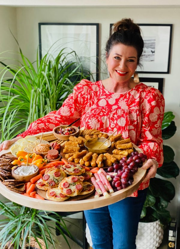 woman holding a Epic Ultimate Game Day Tray