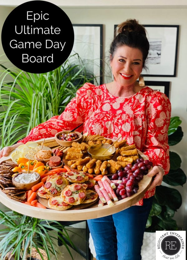 woman holding an Epic Ultimate Game Day Board for a party