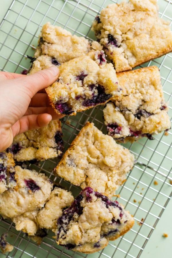 taking a bite of Best Blueberry Kuchen