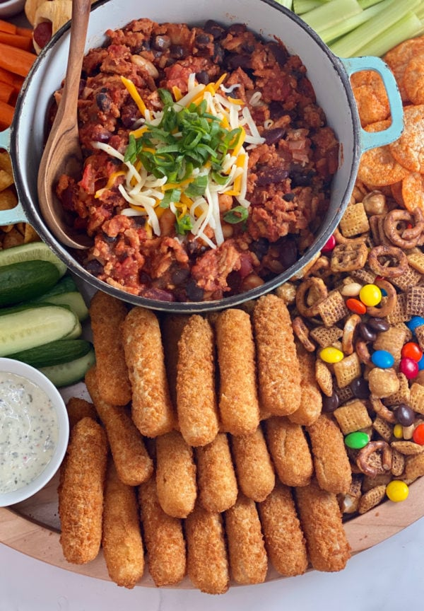 pot of chili with game day snacks