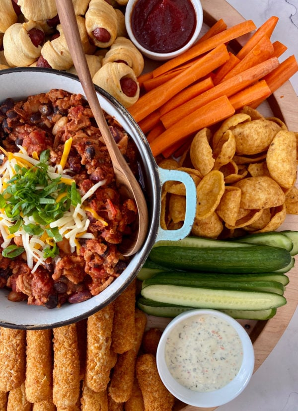 pot of chili with cheese, with other snacks