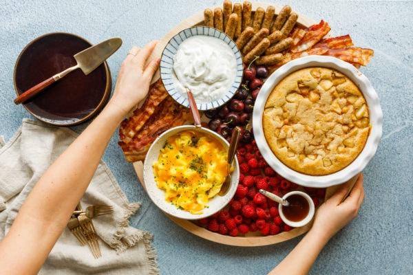 setting down a pear cake breakfast board