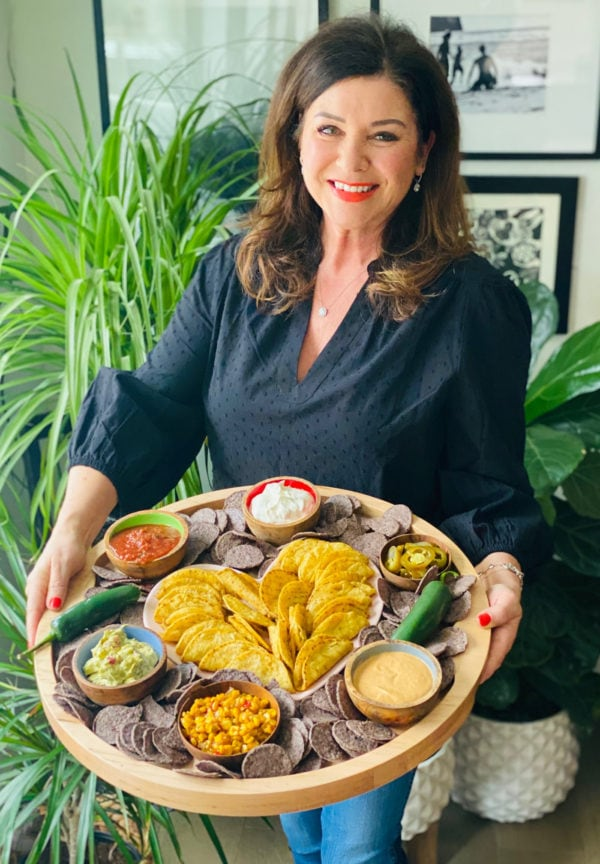 woman holding a Chicken Taco Dipping Board