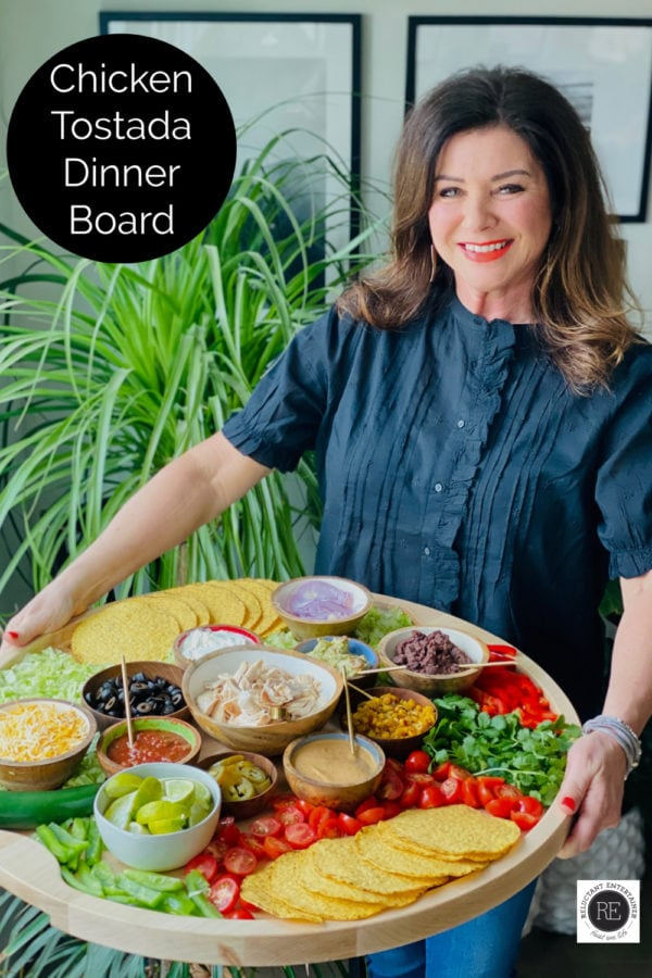 woman holding lazy susan tostada board