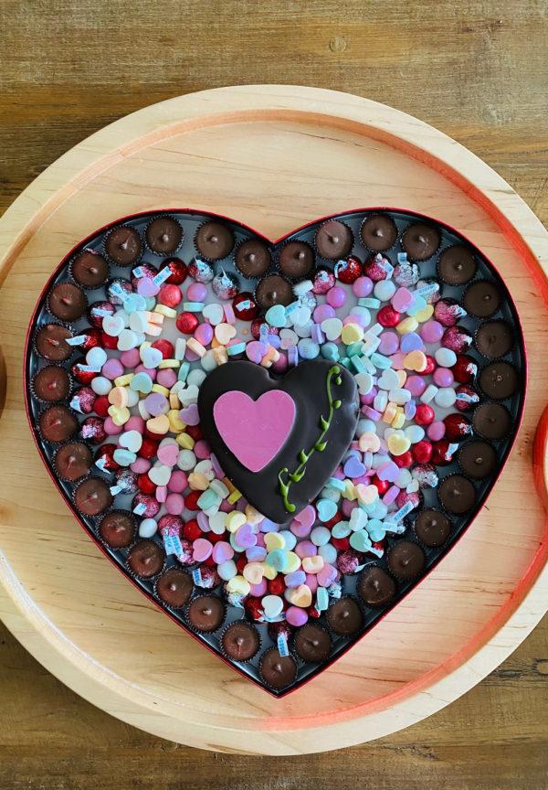 a heart shaped chocolate box on a board