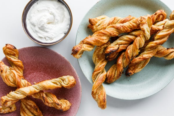 Puff Pastry Orange Twists on plates with cream