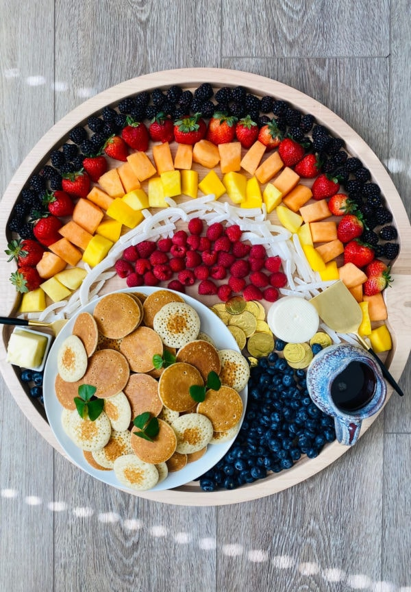 silver dollar pancakes on a rainbow breakfast board