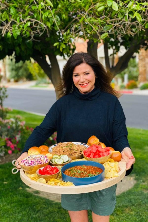 woman holding a BBQ Pork Slider Dinner Board