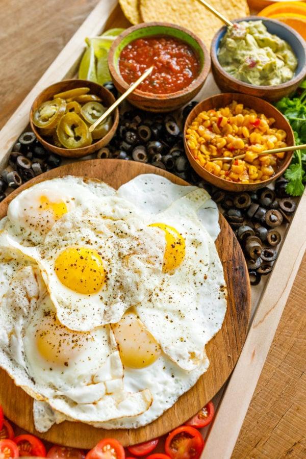 over easy eggs on Mexican Tostada Breakfast Board