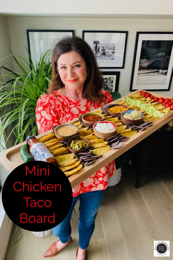 woman holding mini chicken tacos