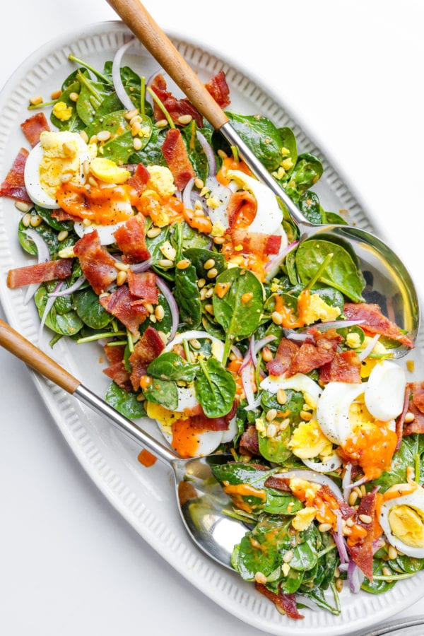 Spinach Salad with Warm Dressing on platter