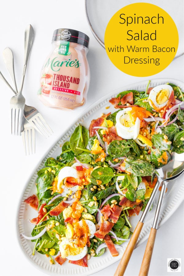 Spinach Salad with Warm Bacon Dressing on platter
