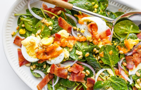 jammy eggs on Spinach Salad with Warm Bacon Dressing
