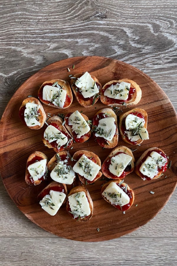 Strawberry Brie Crostini Appetizer on a wood plate