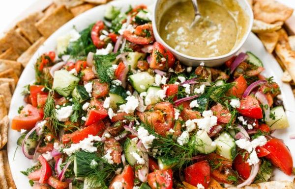 Tomato Cucumber Herb Salad with tahini dressing