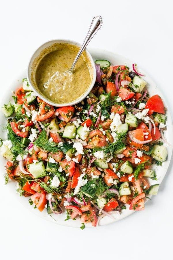 Tahani dip with Tomato Cucumber Herb Salad