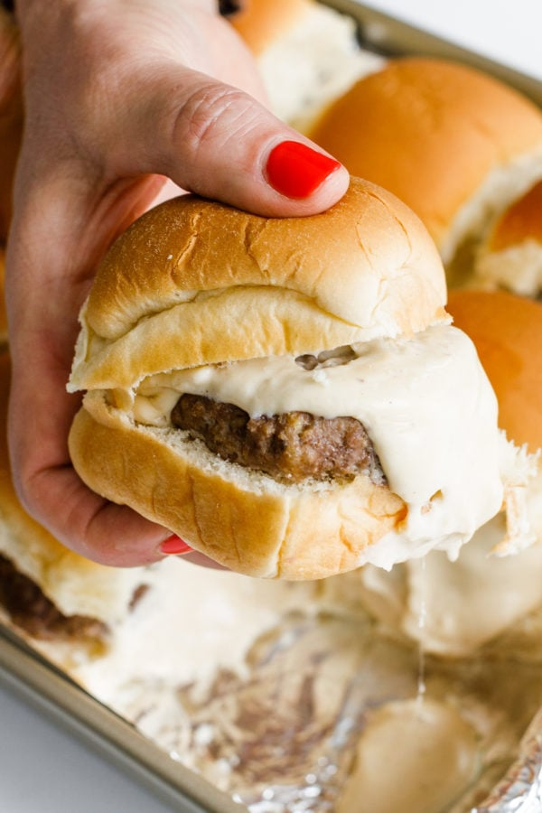 holding a Best Beer Cheese Slider on aloha roll