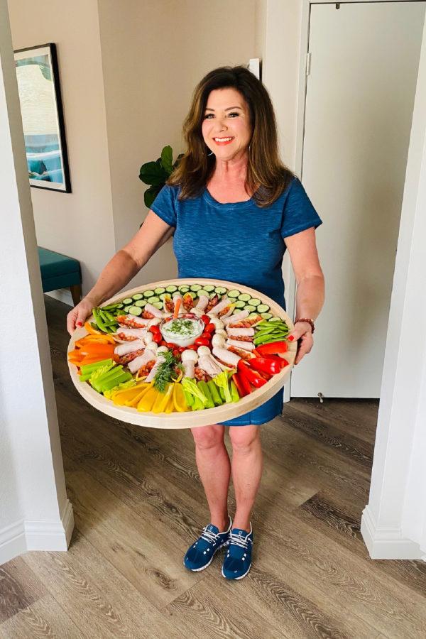 holding a round veggie board