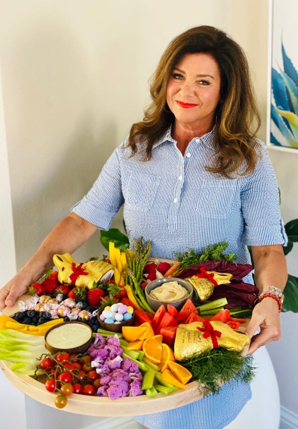 woman holding an Easter crudite board