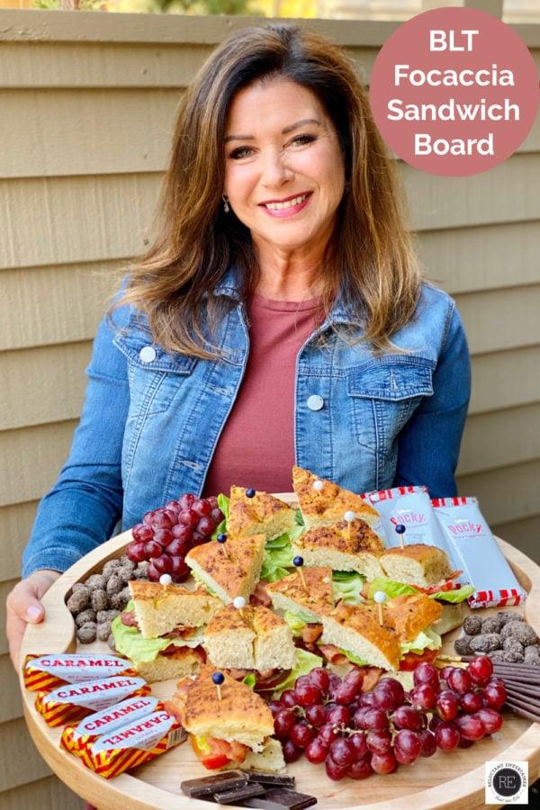 woman holding a BLT Focaccia Sandwich Board