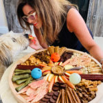 woman and dog with a Dog Charcuterie Board