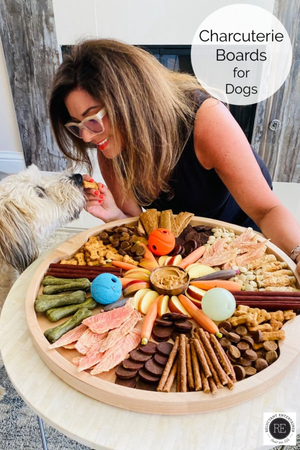 a round dog charcuterie board with a whoodle dog