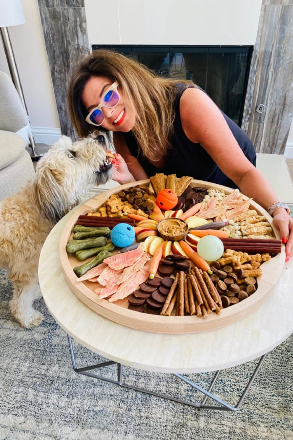whoodle dog, a woman holding a dog charcuterie board