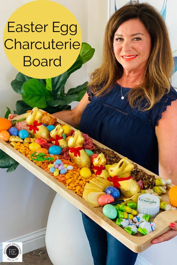 woman holding a Easter Egg Charcuterie Board