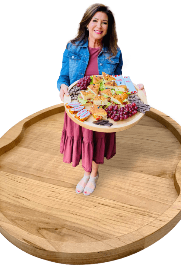 woman holding a food board standing on a board