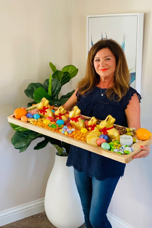 woman holding a 12 x 36 inch Easter Egg Charcuterie Board