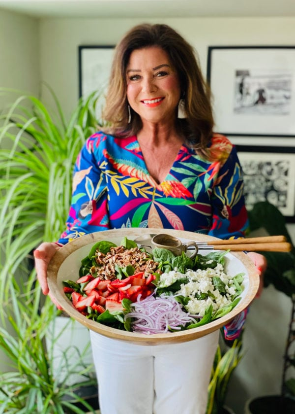 woman holding a Strawberry Spinach Salad