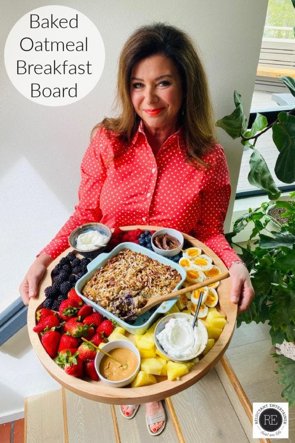 woman holding a Baked Oatmeal Breakfast Board
