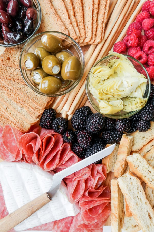 bread stick, olives, meat, cheese, fruit