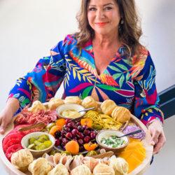 woman holding a round Summer Lunch Turkey Sandwich Board